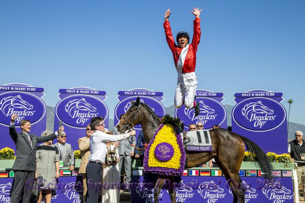 ARCADIA, CA - NOVEMBER 05: Lanfranco Dettori, leaps off of Queen's Trust #11, after winning the Breeders' Cup Filly & Mare Turf during day two of the 2016 Breeders' Cup World Championships at Santa Anita Park on November 5, 2016 in Arcadia, California. (Photo by Alex Evers/Eclipse Sportswire/Breeders Cup)
