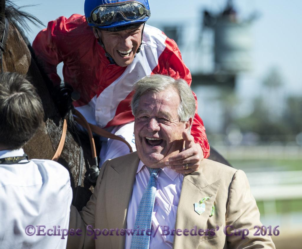 ARCADIA, CA - NOVEMBER 05: Lanfranco Dettori, aboard Queen's Trust #11, celebrates after winning the Breeders' Cup Filly & Mare Turf during day two of the 2016 Breeders' Cup World Championships at Santa Anita Park on November 5, 2016 in Arcadia, California. (Photo by Alex Evers/Eclipse Sportswire/Breeders Cup)